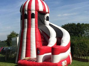 inflatable helter skelter slide hire