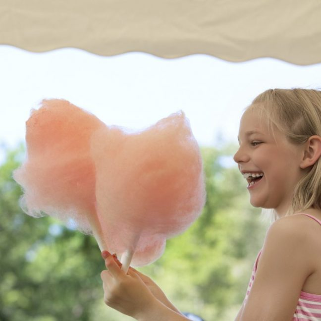 Girl eating Candy Floss at Natasha's Wedding