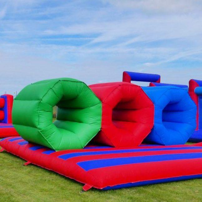 Inflatable barrel crawl assault course hire