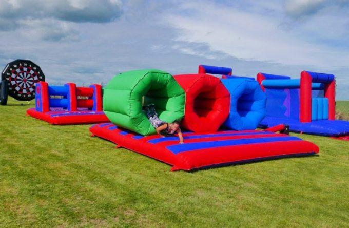 Inflatable barrel crawl hire kent