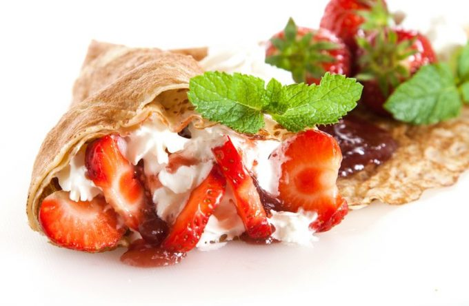 14714291 - rolled thin pancakes with strawberry, sweet cream and mint