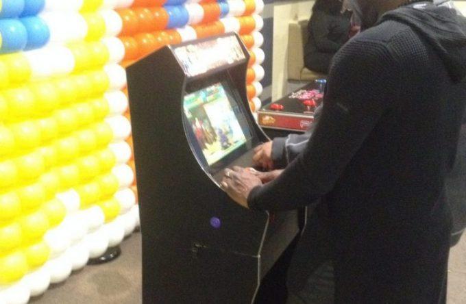 gamer playing retro arcade game
