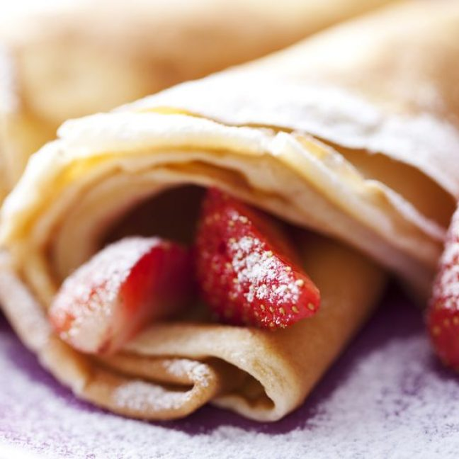 8955504 - sweet thin french style crepes, served with strawberries and castor sugar, very close up and very shallow dof for a dreamy effect, focus on the strawberry in front
